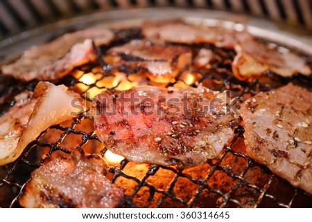 Pork grill on hot coals. This kind of food is a Korean or Japanese BBQ style. - stock photo