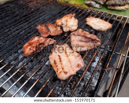 Pork grilled on charcoal (Thai style food) - stock photo