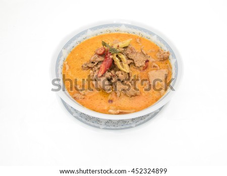 """Pork in ground peanut-coconut cream curry or Thai say """"Pa Naeng Moo"""", Used milk or coconut milk,kaffir lime leaves and curry for cook, on white background or isolate - stock photo"""