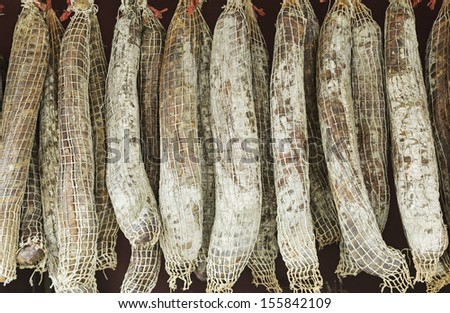 Pork loin hanging in deli, meal and food - stock photo