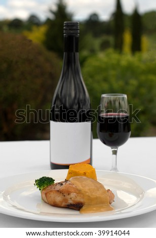 Pork Loin, served with a Roasted Pumpkin Timbale and Piquant Honey Sauce, accommpanied by a glass of Merlot
