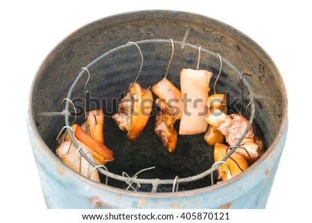pork meat hanged on hook and grilled by fire,thai tradition in countryside to grill pork. - stock photo