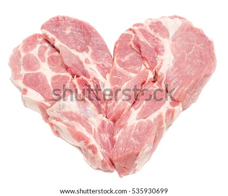 Pork meat in heart form isolated on white background