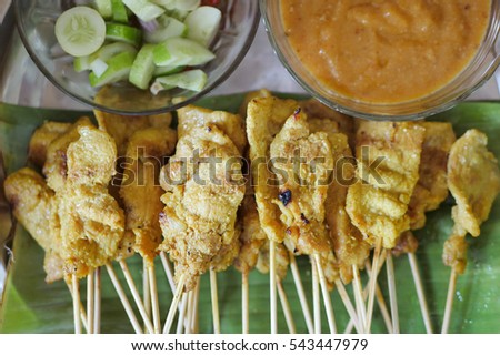 pork meat satay, asian bbq with peanut dip sauce