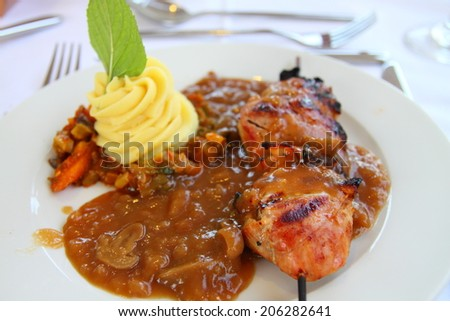 Pork medallions with mushroom sauce and mashed potatoes - stock photo
