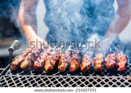 Pork on skewers cooked on barbecue grill. - stock photo