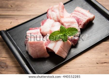 Pork on wood background,Pork belly - stock photo