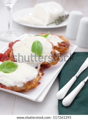 Pork or veal parmigiana in bread crumbs fried - stock photo