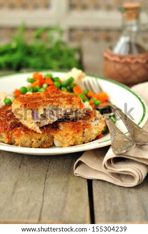 Pork patties with mixed vegetables, copy space for your text