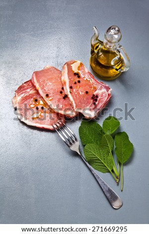 pork raw loin with olive oil & sage.ingredients - stock photo