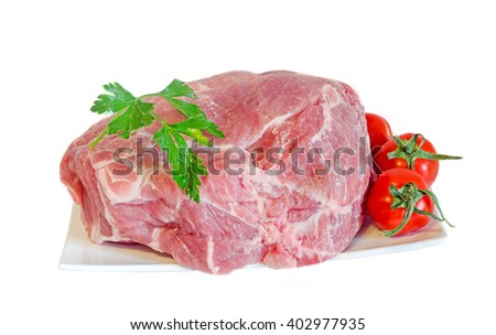 Pork raw meat on a white plate, decorated with green parsley and cherry tomatoes, close up, white background. - stock photo