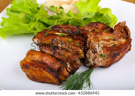 Pork ribs bbq with dill and salad leaves