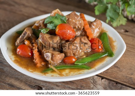 Pork ribs braised with soy sauce and vegetable. - stock photo