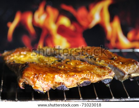 pork ribs on a grill - stock photo
