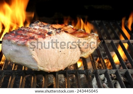 Pork Ribs on Flaming BBQ Grill - stock photo