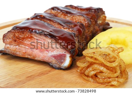 pork ribs with fried onions and apples barbecue - stock photo