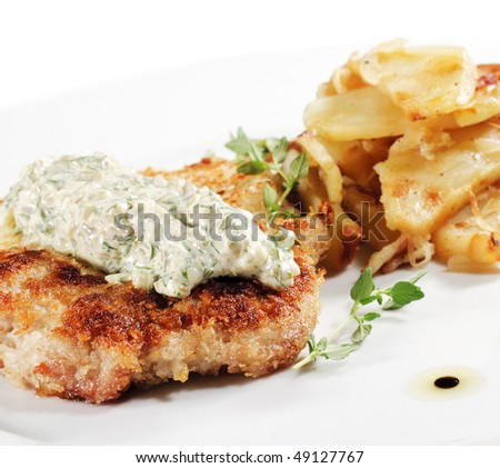 Pork Schnitzel with Fried Potato and Sauce Tartar