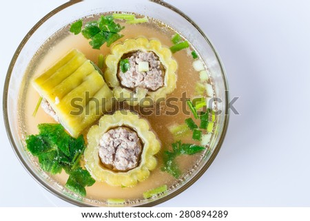 Pork soup with bitter gourd and carrot in Glass bowl. - stock photo