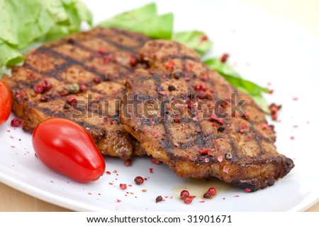 pork steak,grilled with salad - stock photo