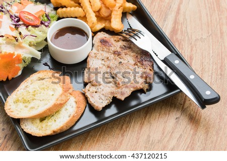 pork steak in plate on the table