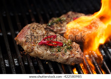 pork steak meat on bbq grill with flame, home made