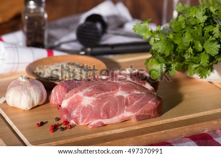 Pork steak on a cutting wooden board