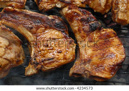 pork steak on a grill - stock photo