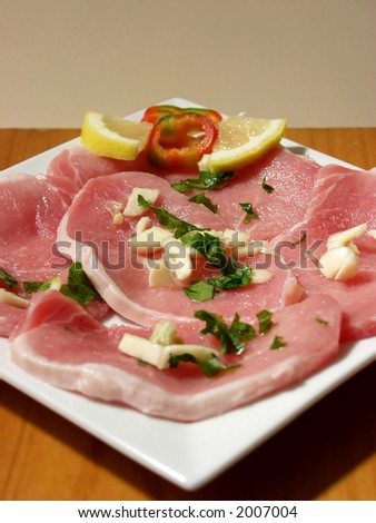 pork steak whit garlic and parsley - stock photo