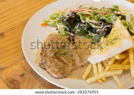 Pork steak with mushroom sauce - stock photo