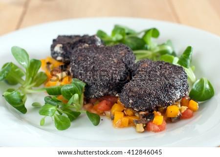 Pork Tenderloin in Poppy Seeds with olive salsa - stock photo