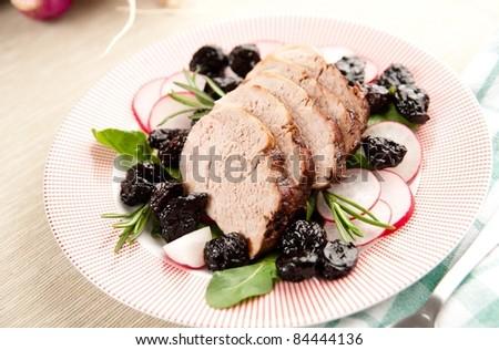 Pork Tenderloin with Cherry Sauce and Mushrooms - stock photo