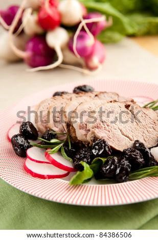 Pork Tenderloin with Cherry Sauce, Mushrooms and Radishes - stock photo