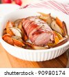 Pork Tenderloin Wrapped in Prosciutto and Roasted with Vegetables and Pears - stock photo