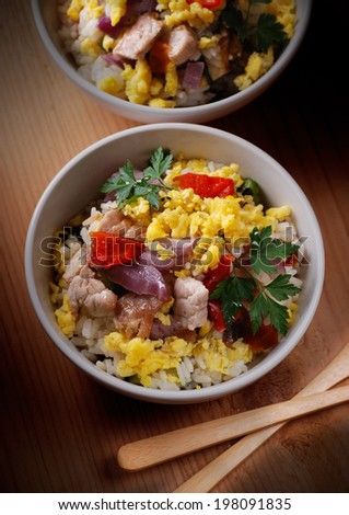 pork, vegetables and scrambled eggs in white bowl