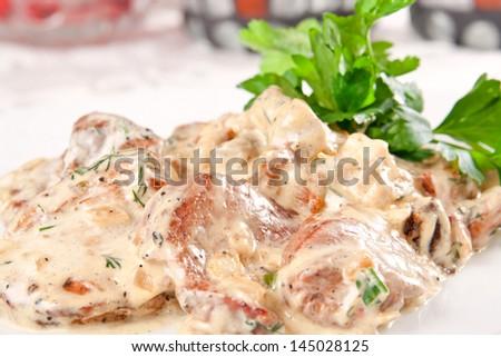 Pork with mushrooms and cream sauce - stock photo