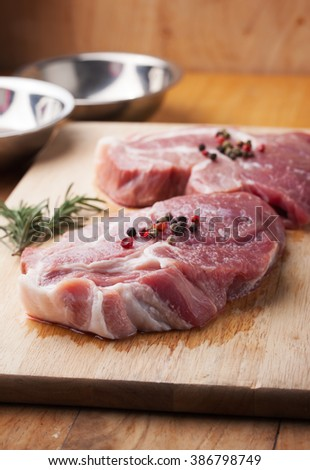 pork with pepper prepare for grill on chopping block - stock photo