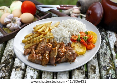 pork with rice and potatoes - stock photo