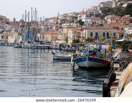 Poros, Greek Island, showing traditional fishing boats and local architecture