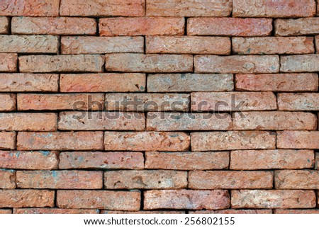 Porous red bricklaying without filling with cement, background - stock photo