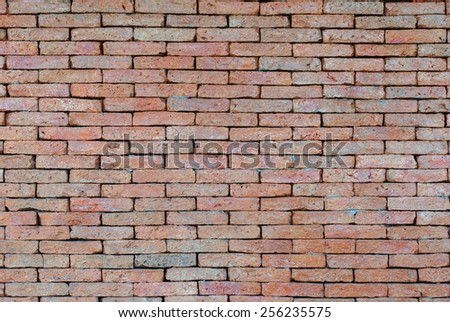 Porous red bricklaying without filling with cement, background. Horizontal image - stock photo