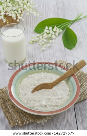 Porridge in a bowl on a wooden table