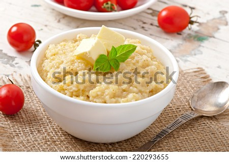 Porridge in a bowl with butter
