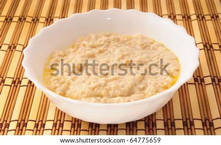 porridge in white bowl with butter - stock photo