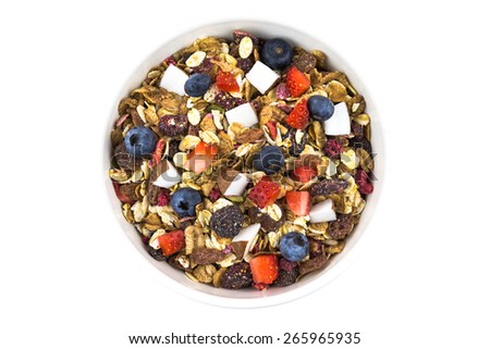 Porridge oats with fresh and dried fruit in a bowl on white background - stock photo