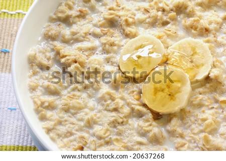 Porridge with banana and honey.  Traditional Scottish oatmeal. - stock photo