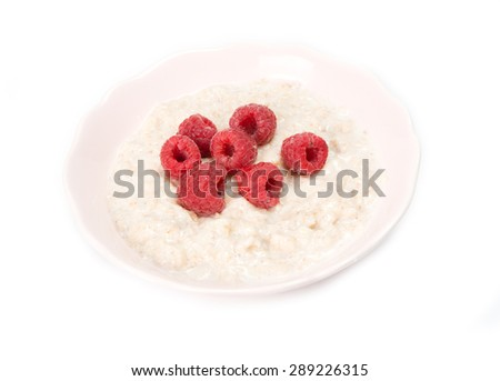 porridge with fresh raspberry isolated on a white background