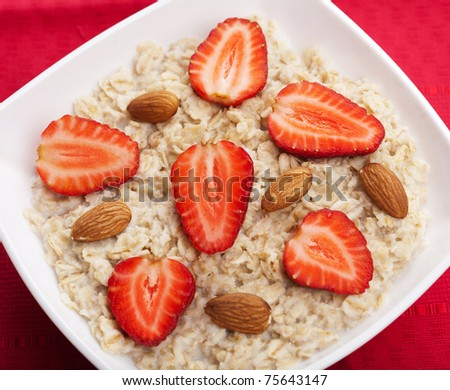 porridge with fresh strawberry - stock photo