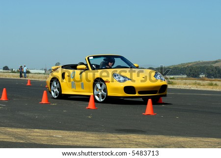 Porsche Boxster competing in PCASB autocross race at Oxnard, California airport