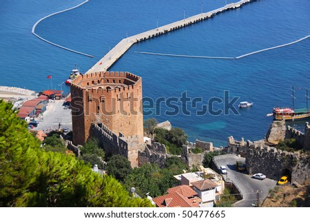 Port Alanya and red brick tower - stock photo