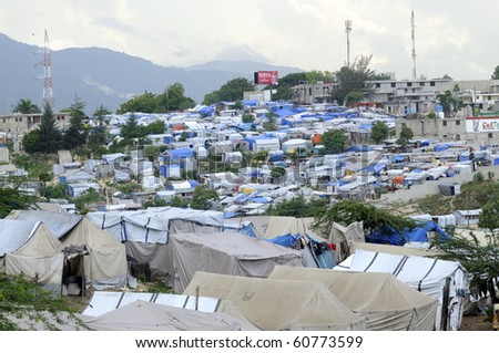 PORT-AU-PRINCE - AUGUST 28:   A big Tent city for the Victims of the earthquake  on August 28, 2010 in Port-Au-Prince, Haiti - stock photo